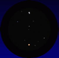 A simulated telescope view of Mars passing the double-star Graffias (Beta-1 Scorpii) on March 16th 2016. South is up and East to the right; the field of view is about 13 arcminutes. Click for full-size animation, 67 KB (Copyright Martin J Powell, 2015)