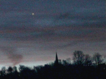 Venus seen through thin cloud at daybreak (Copyright Martin J Powell, 2004)